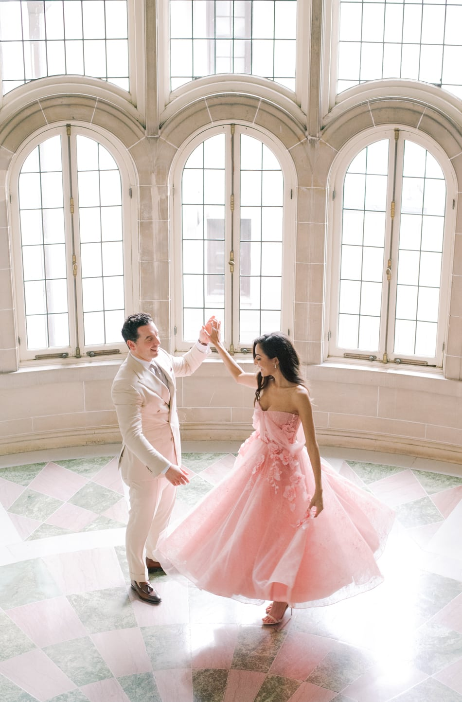Bride and groom dancing on grand stairs at Armour House